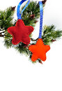 Christmas toys hanging on a Christmas tree on a white background