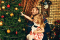 Christmas toys happy father and his little daughter decorating the tree at home Royalty Free Stock Photos