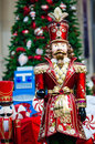 Christmas toys scene with holiday decorations tree left by santa claus with giant victorian toy nutcracker king Stock Image