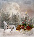 Christmas travel santa s sledge in an enchanted winter scenery Stock Images