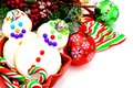 Christmas treats collection of cookies candy baubles and branches over white Stock Images