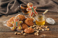 Christmas treats on plate and cup of tea on plaid close-up Royalty Free Stock Photo