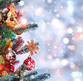Christmas tree background and Christmas decorations with blurred, sparking, glowing and text Merry Christmas and Happy New Year