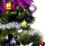 Christmas Tree background with colored toys Royalty Free Stock Photo
