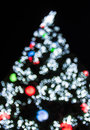 Christmas tree background with defocused lights Royalty Free Stock Photo