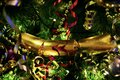 Christmas Tree with baubles and gold metallic ribbons Royalty Free Stock Photo
