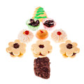 Christmas tree biscuits some cookies arranged in a shape over white Royalty Free Stock Photos