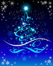 Christmas  tree on blue  background Stock Photos