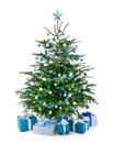 Christmas tree in blue and silver with gift boxes stylish studio shot of a beautiful lush decorated matching arranged front of Royalty Free Stock Photography
