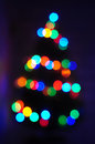 Christmas tree bokeh of with colorful lights at night Royalty Free Stock Photos