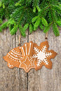 Christmas tree branch with gingerbread cookies decoration Royalty Free Stock Photo