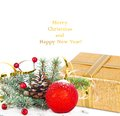 Christmas tree branch with gold serpentine gift box and red sphere on white background Royalty Free Stock Photos