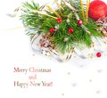 Christmas tree branch with gold serpentine and red sphere on white background isolated Stock Photos