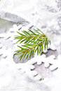 Christmas tree branch and silver ribbon close up white christma ornaments on soft grey background time Royalty Free Stock Images