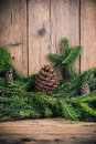 Christmas tree branches with bumps on wooden background Stock Photo