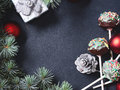 Christmas tree branches with cake pops and baubles Royalty Free Stock Photo