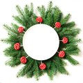 Christmas tree branches and red lolipop as decor on a white background. View from above. Royalty Free Stock Photo