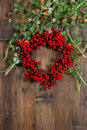 Christmas tree branches and wreath from red berries. festive dec Royalty Free Stock Photo