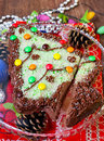 Christmas tree cake shaped and decorated like Stock Images