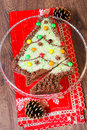 Christmas tree cake shaped and decorated like Stock Photography
