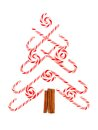 Christmas tree of candy canes and peppermint swirls over white made a background Royalty Free Stock Images