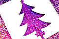 Christmas tree card beautiful white cutout of a purple on sparkly paper Royalty Free Stock Images