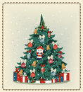 Christmas tree with Christmas toys and gifts in the old vintage Royalty Free Stock Photo