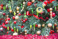 Christmas tree close up on a and ornaments Royalty Free Stock Images