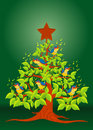 Christmas tree with colorful birds singing and wooden star on green background Royalty Free Stock Photo