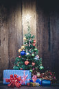 Christmas tree with colorful ornaments a wood background Royalty Free Stock Photo