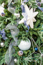 Christmas tree decorated with blue and white a fresh ornaments Royalty Free Stock Images