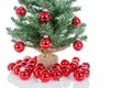 Christmas tree decorated with red balls isolated at white