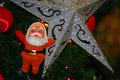 Christmas tree decoration close up santa claus and star on Stock Photos