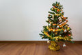 Christmas tree decoration in empty room with white wall Royalty Free Stock Photo