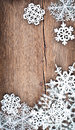 Christmas tree decoration and snowflakes on wooden background Royalty Free Stock Photo