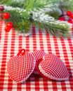 Christmas tree decorations and branch on red gingham tablecloth in heart shape winter holidays concept Stock Photography