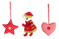 Christmas tree decorations collection photo of a set of fabric decorative items star heart and santa claus to be hung up on Stock Photos