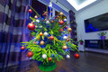 Christmas tree with decorations at home in the dark living room Royalty Free Stock Images