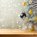 Christmas tree and decorations over bokeh lights background. Black, golden and silver ornaments Royalty Free Stock Photo
