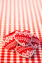 Christmas tree decorations on red gingham tablecloth in heart shape winter holidays concept copy space for your text Stock Image