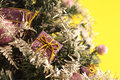 Christmas tree with decorations on yellow background detail of a decorated conceptual image about Royalty Free Stock Photography