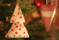 Christmas tree and fabric heart in reflective light with bauble background Royalty Free Stock Image