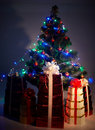 Christmas tree with flash, group gift box, shadow Stock Photo
