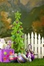 Christmas tree in front of picket fence Royalty Free Stock Photo