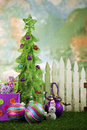 Christmas tree in front of picket fence Stock Photos