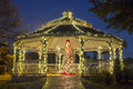 Christmas tree and gazebo a beautifully lit in a city park at time with a inside Royalty Free Stock Photos