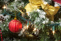 Christmas tree gold ribbon, red bauble and lights Royalty Free Stock Photo