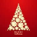 Christmas tree from gold stars on red background Royalty Free Stock Image