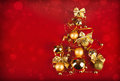 Christmas tree with golden balls on the red background Stock Photos