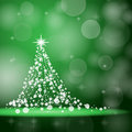 Christmas tree on the green abstract background Stock Image